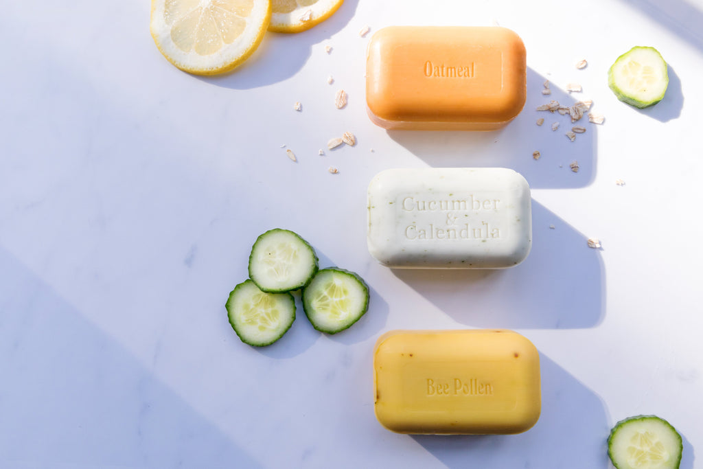 3 Bars bars of soap photographed on a marble counter top with lemon and cucumber slices