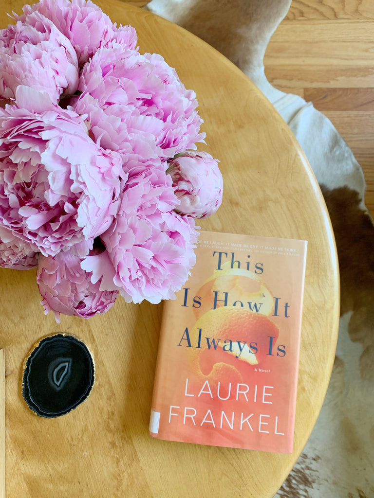 This is how it always is book by Laurie Frankel on coffee table with peonies