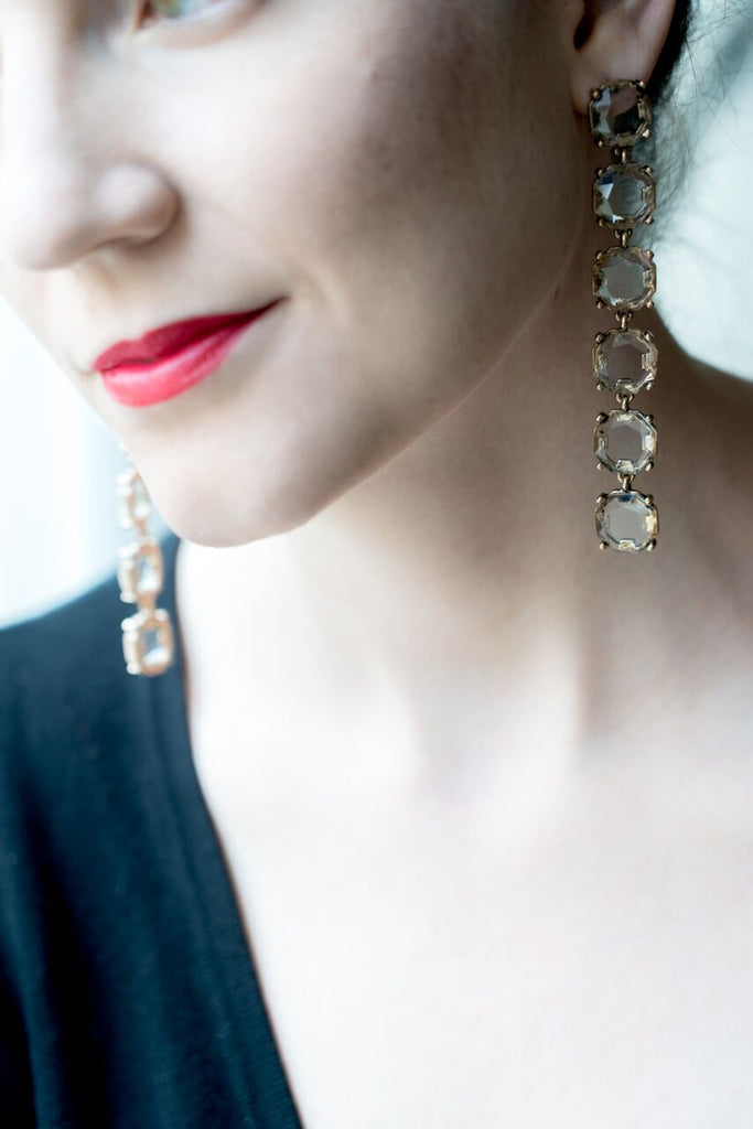 model wearing long shoulder duster crystal drop earrings with red lipstick