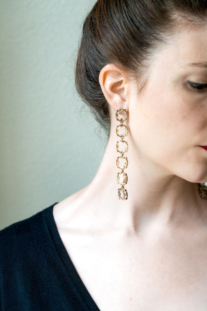 model wearing long shoulder duster crystal drop earrings side view