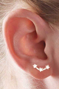 gold star constellation earring on ear