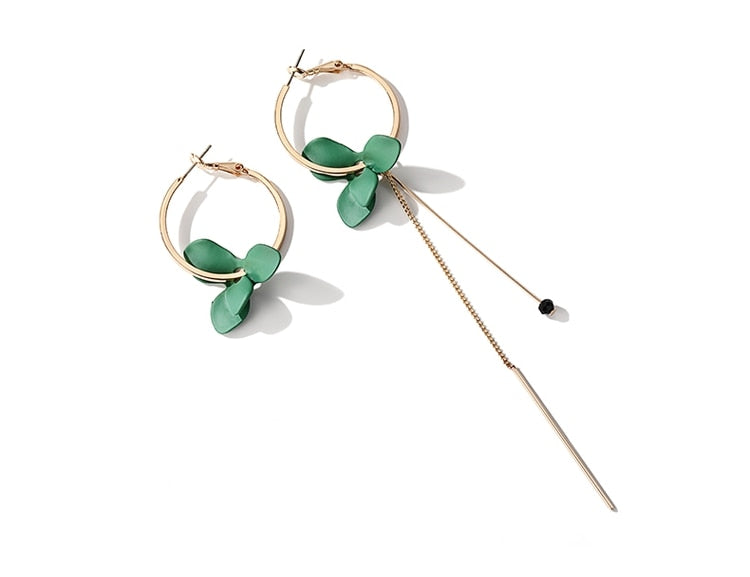 green flower mismatched earrings side view
