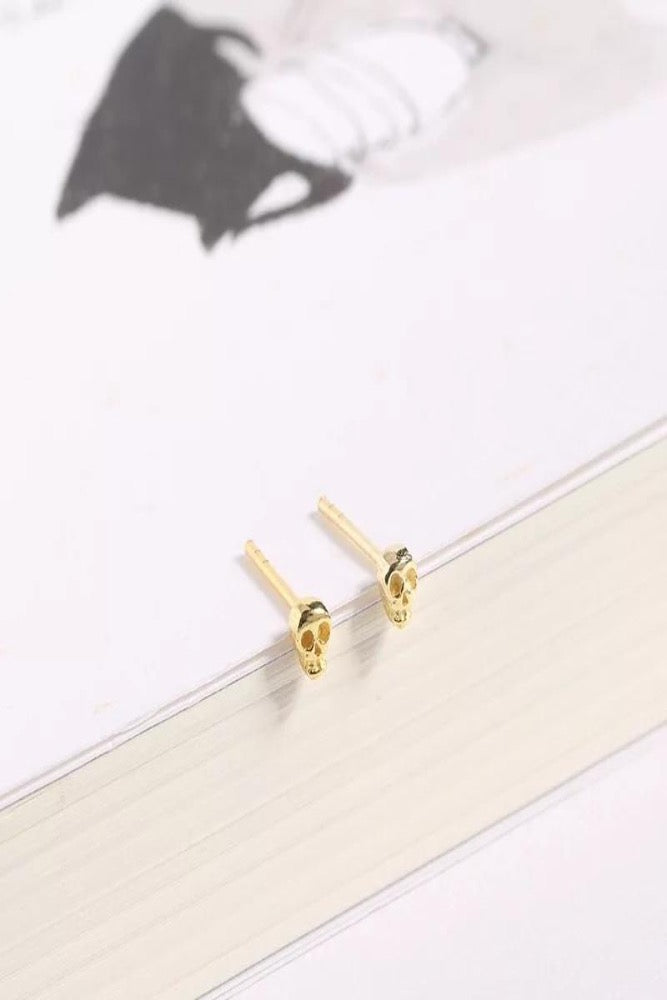 gold tiny skull stud earrings
