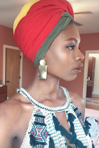 gold statement earrings and headwrap Paola mathe