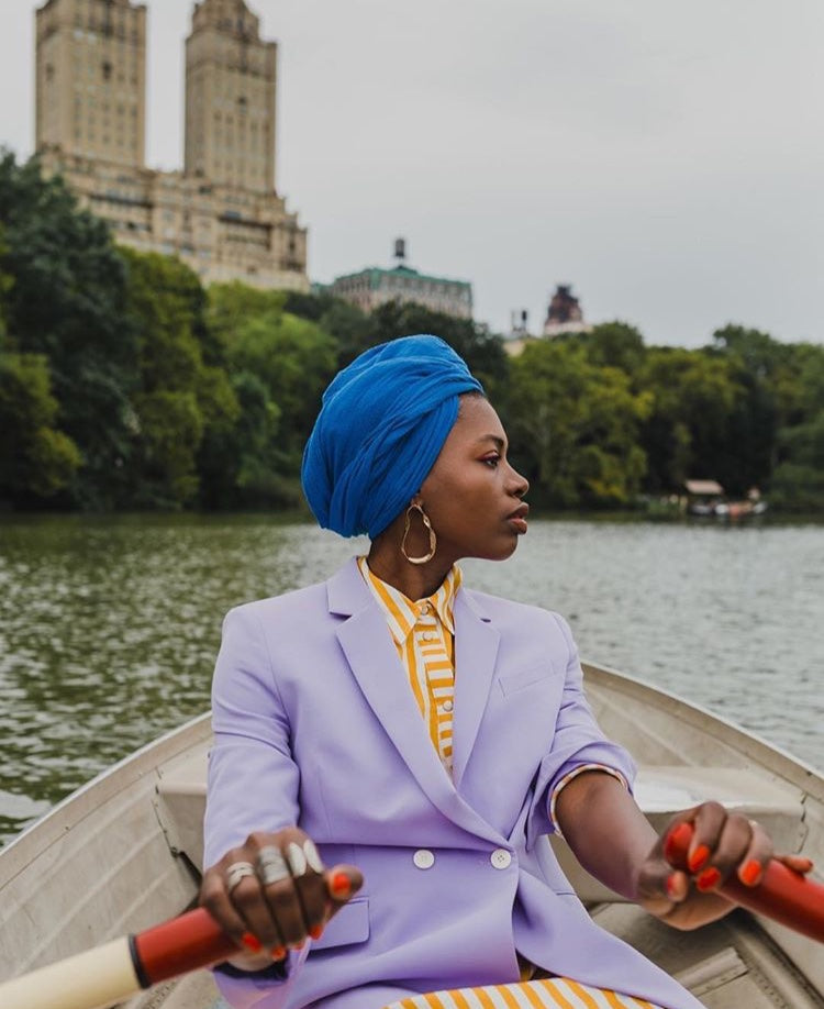 twisted metal earrings on Paola mathe on rowboat New York city lavender double breasted blazer