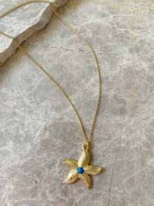 starfish charm necklace with turquoise cabochon