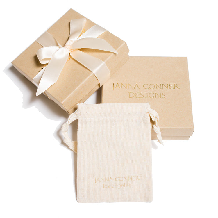 janna Conner branded jewelry pouch and box on white background