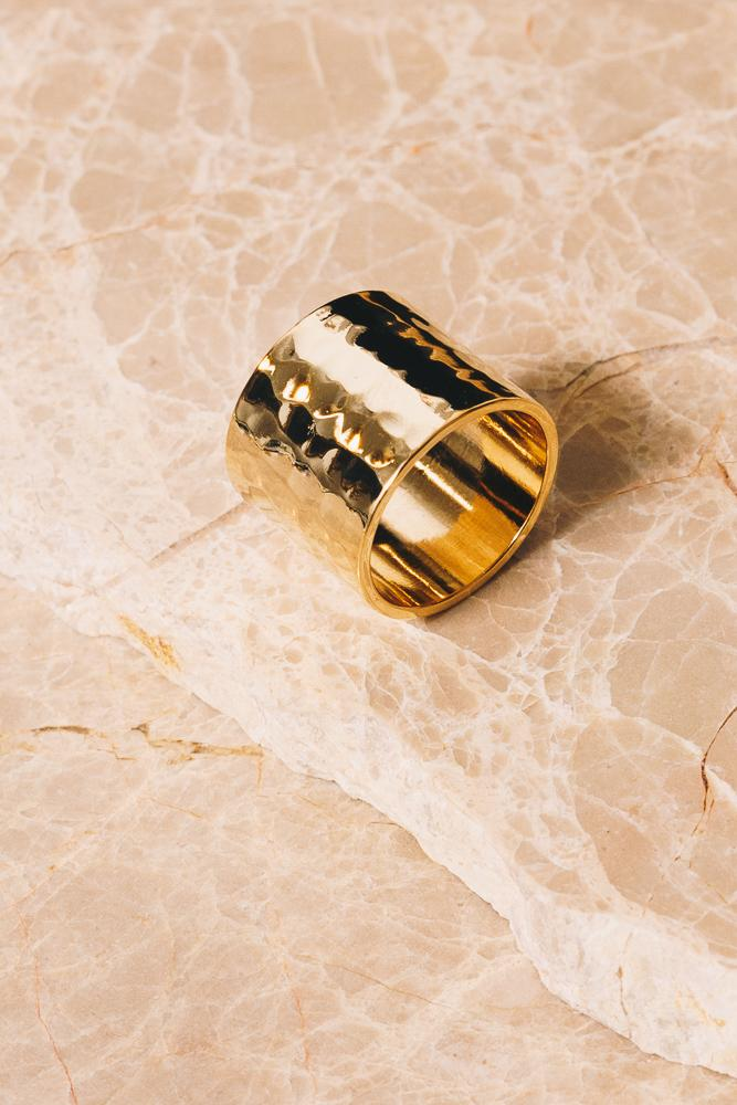 18K Gold plated cigar band ring on beige marble