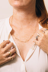 gold paperclip mask chain necklace on model