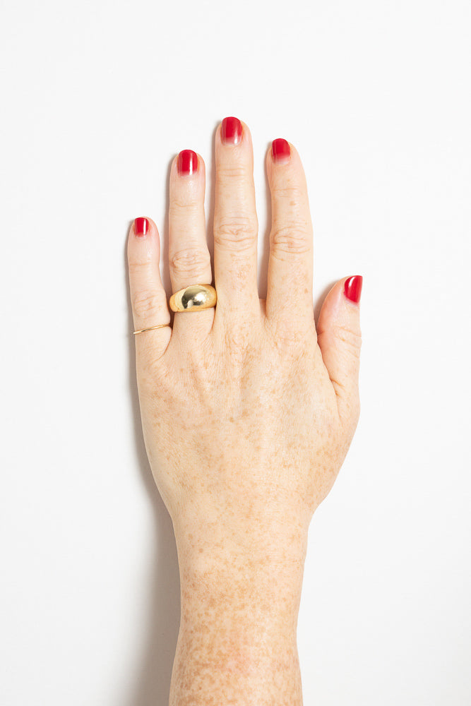 gold dome ring on model hand