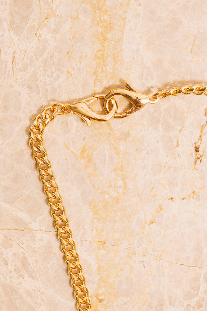gold curb chain lobster clasp detail