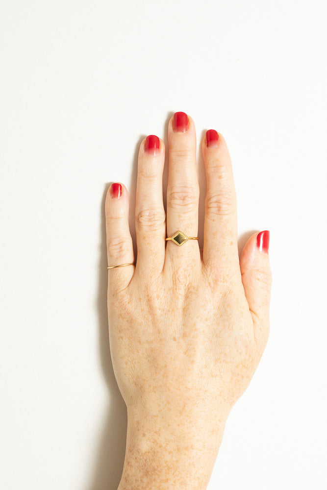 gold triangle stacking ring and pinkie ring on model hand