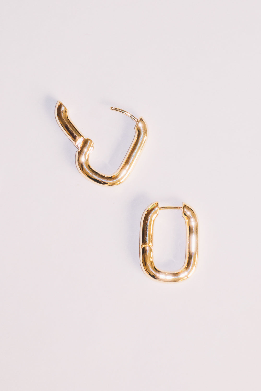 gold huggie hoop earrings with opening