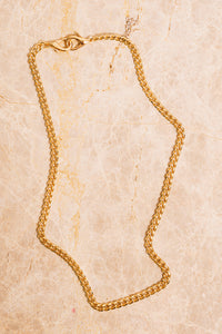 gold curb chain necklace above view