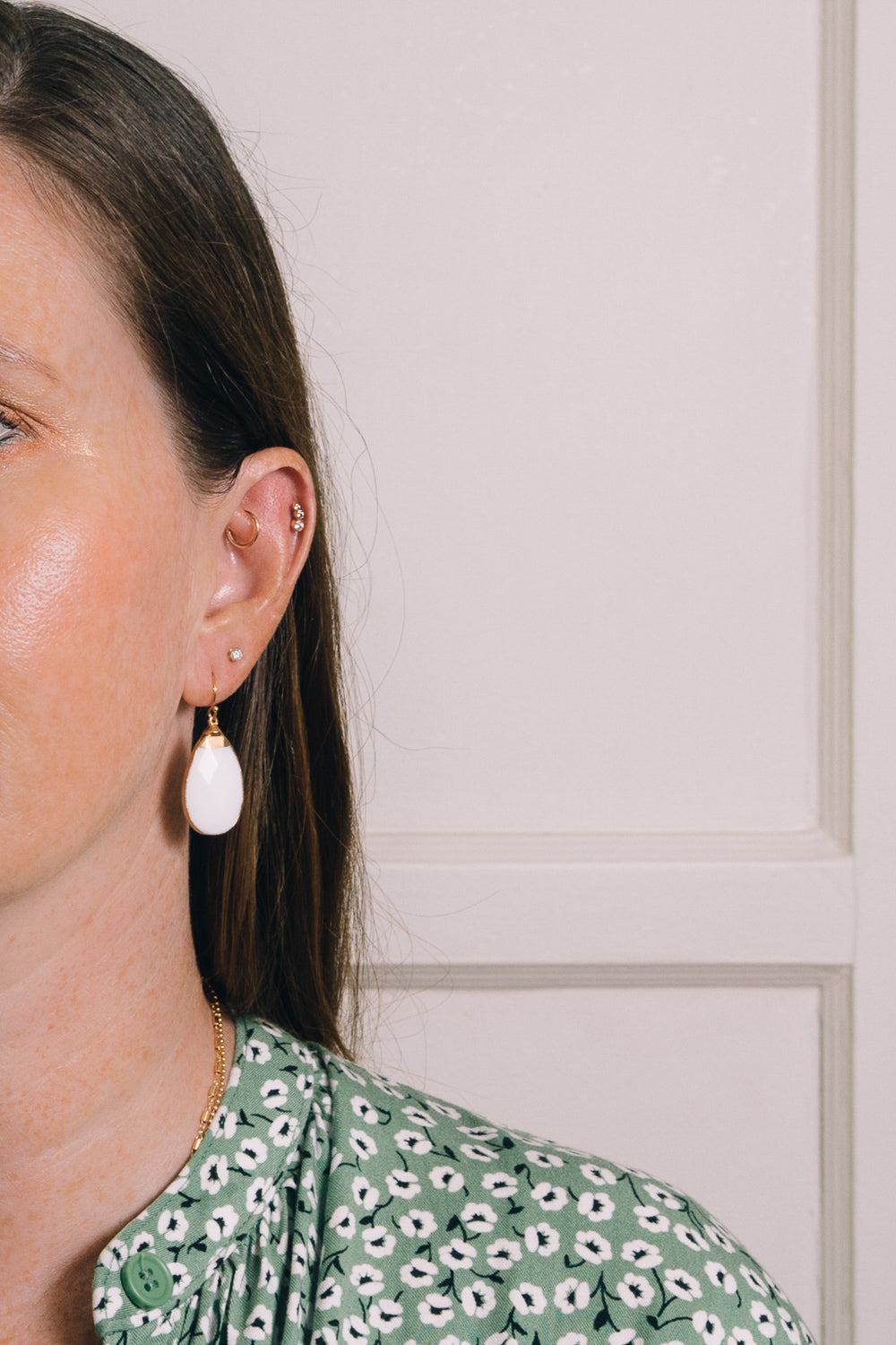 white agate teardrop earrings on model