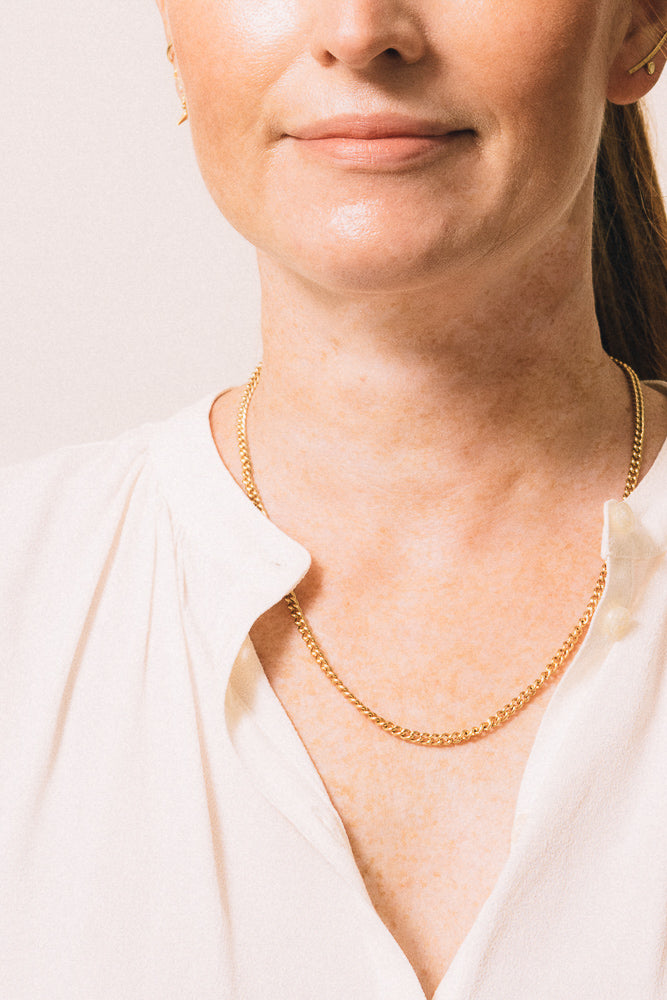 gold chain necklace on model
