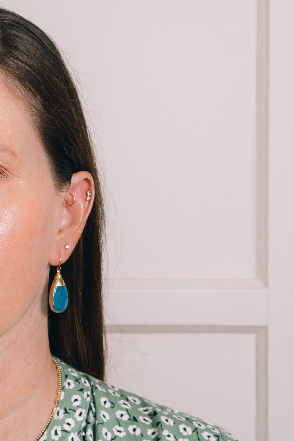 capri blue quartz teardrop earrings on model