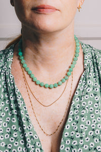 chrysoprase strung bead necklace with layering necklaces on model