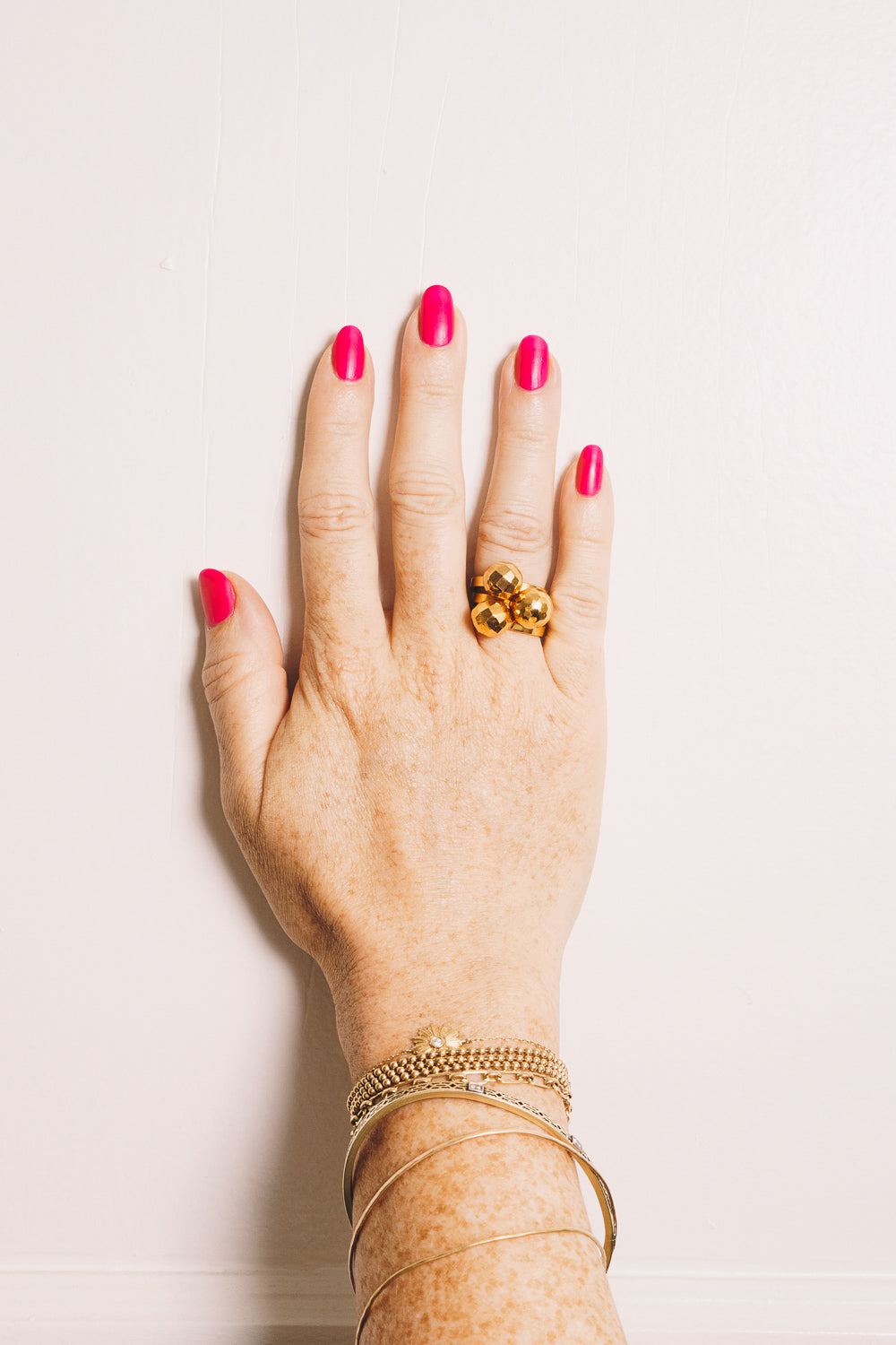 gold ball stacking ring on model hand