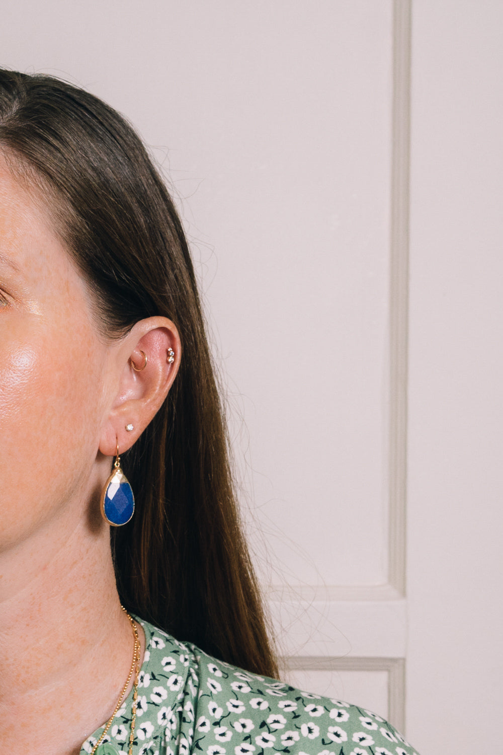 blue jade teardrop earrings on model