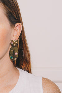 gold stone encrusted statement earrings on model