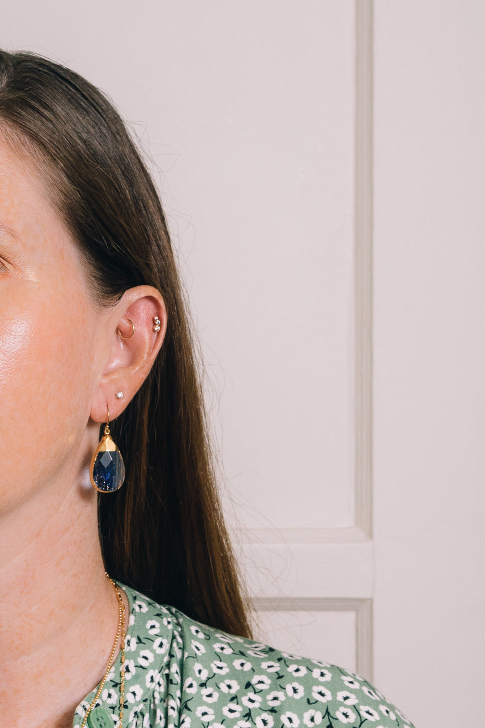 navy blue sunstone quartz teardrop earrings on model