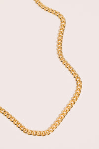 gold curb chain necklace closeup