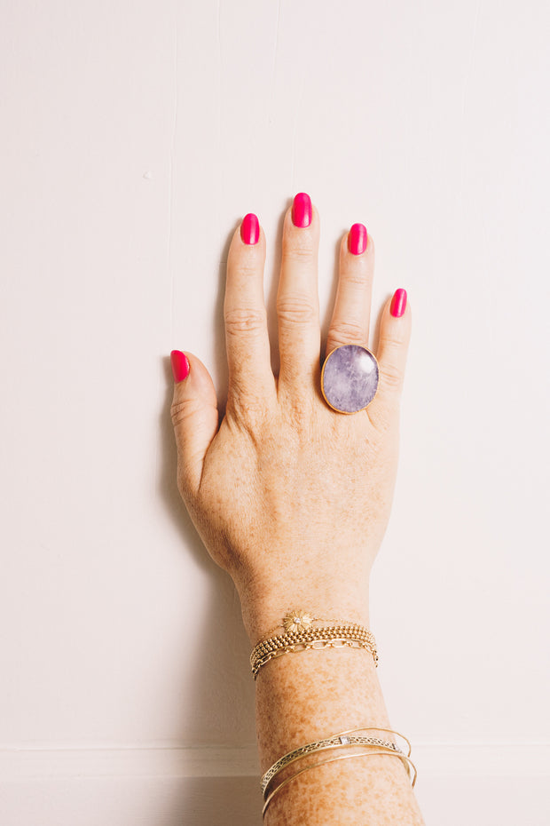 amethyst cocktail ring on hand