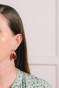 carnelian teardrop earrings on model