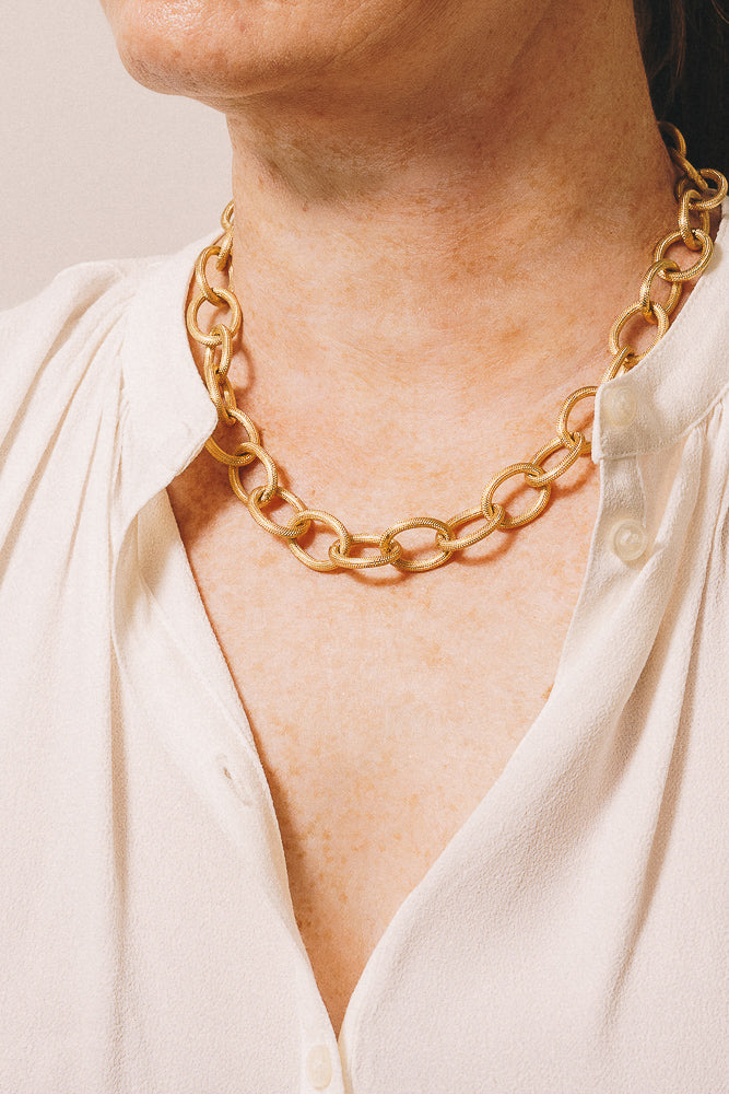 large gold rope chain necklace on model