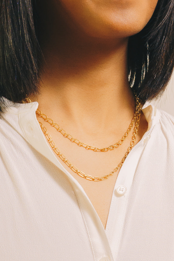 vintage chain link necklaces on model closeup