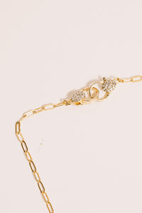 gold link chain necklace crystal clasp closeup