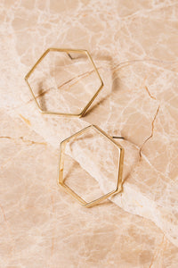 large gold hexagon stud earrings side view