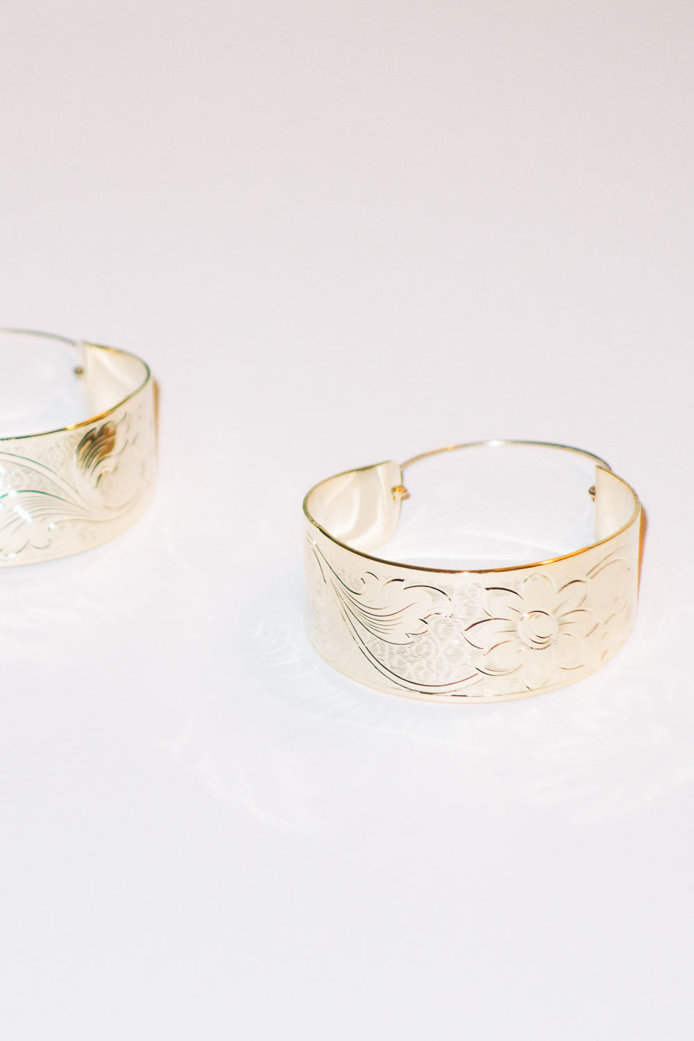 gold basket hoop earrings with flower detail