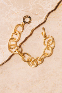 gold link chain bracelet  toggle clasp above view