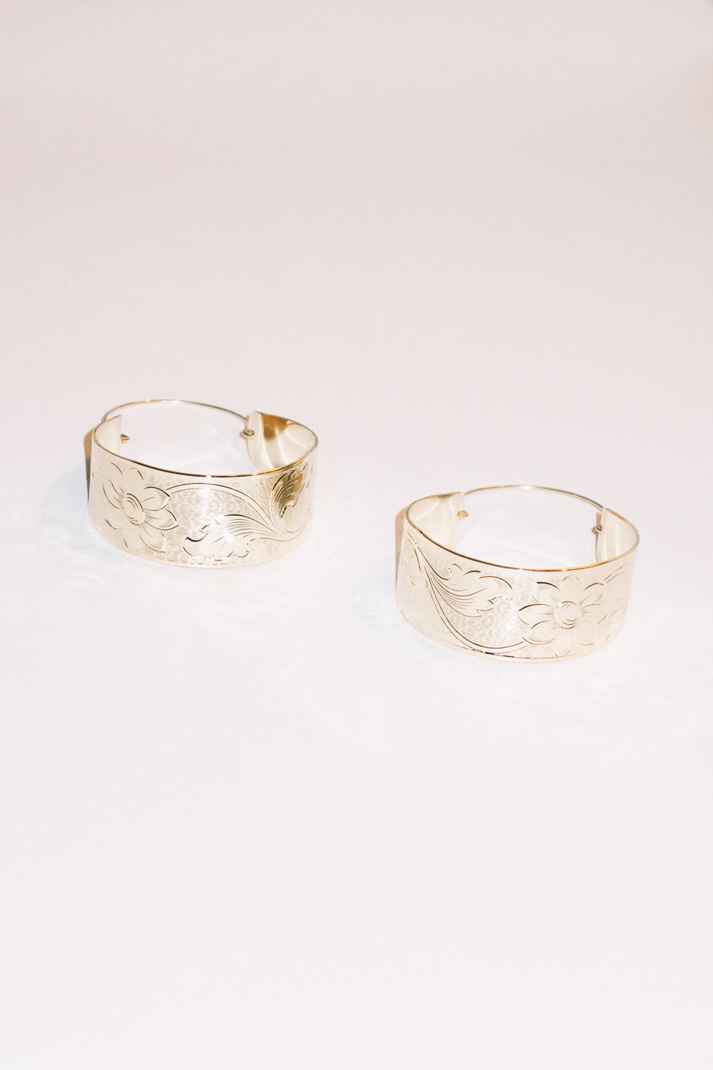 gold basket hoop earrings with engraved flower pattern