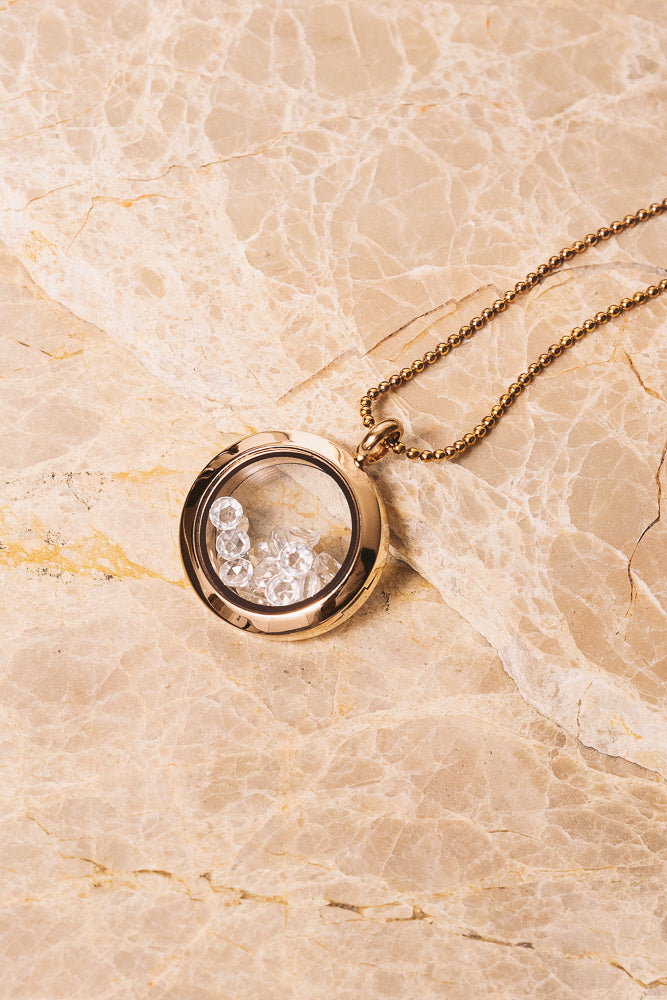 rose gold shaker locket with rose cut white topaz