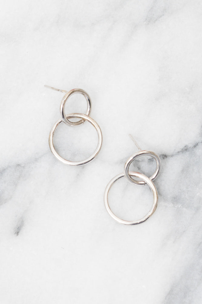 silver linked circle earrings above view