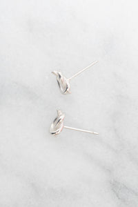 silver pretzel knot earrings above view