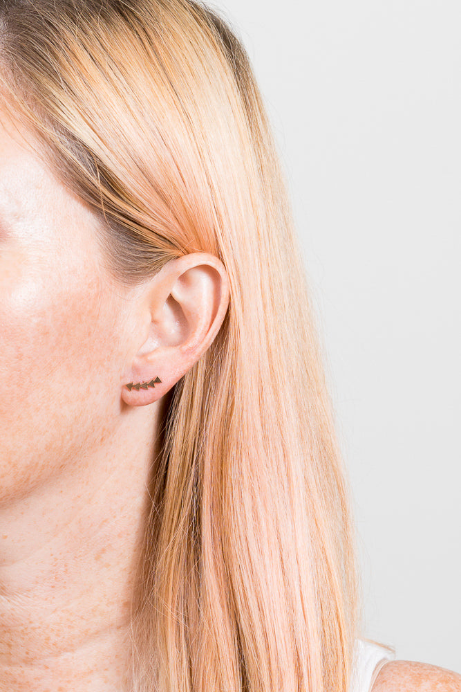 rose gold triangle ear crawler on model