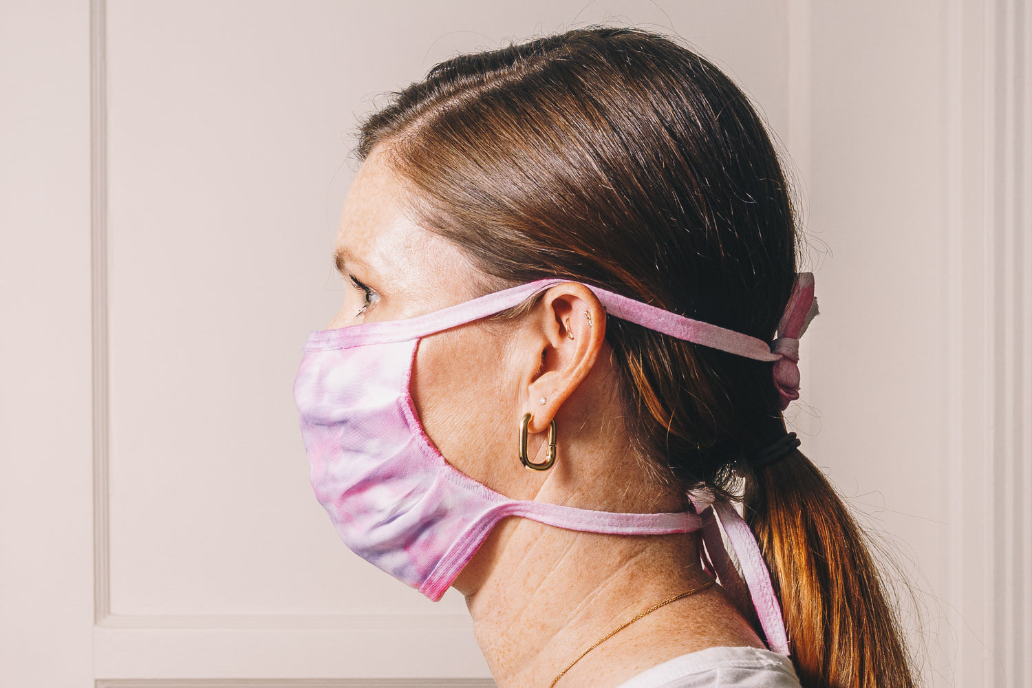 pink purple tie dye handmade face mask adjustable on model side profile
