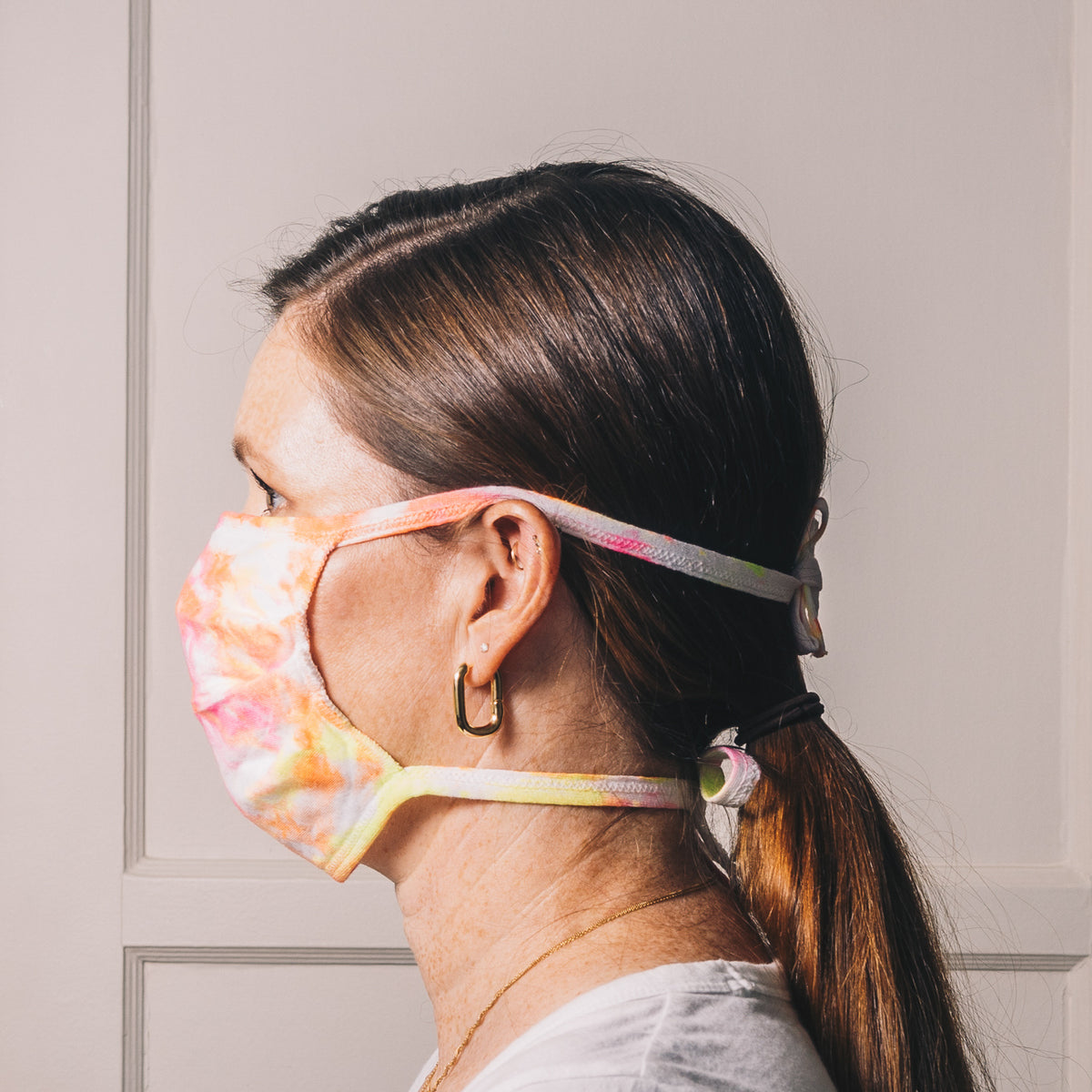 neon tie dye reusable adjustable face mask on model side profile