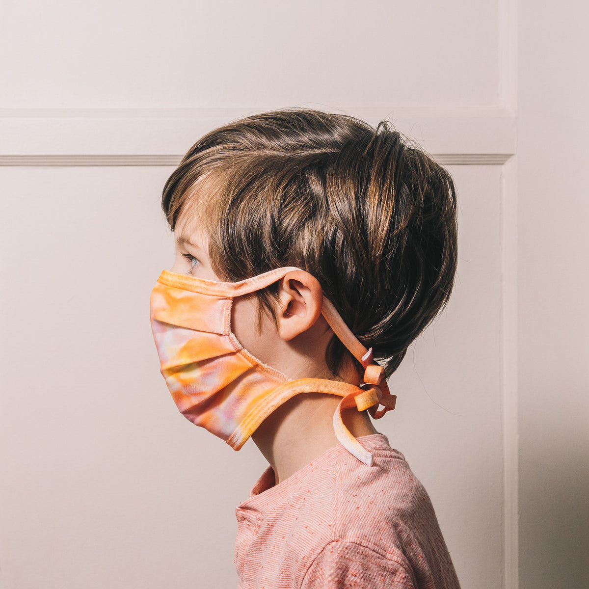orange tie dye reusable adjustable face mask on child