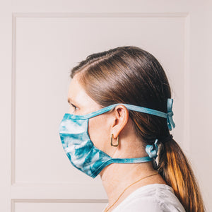 teal tie dye handmade face mask adjustable on model side profile