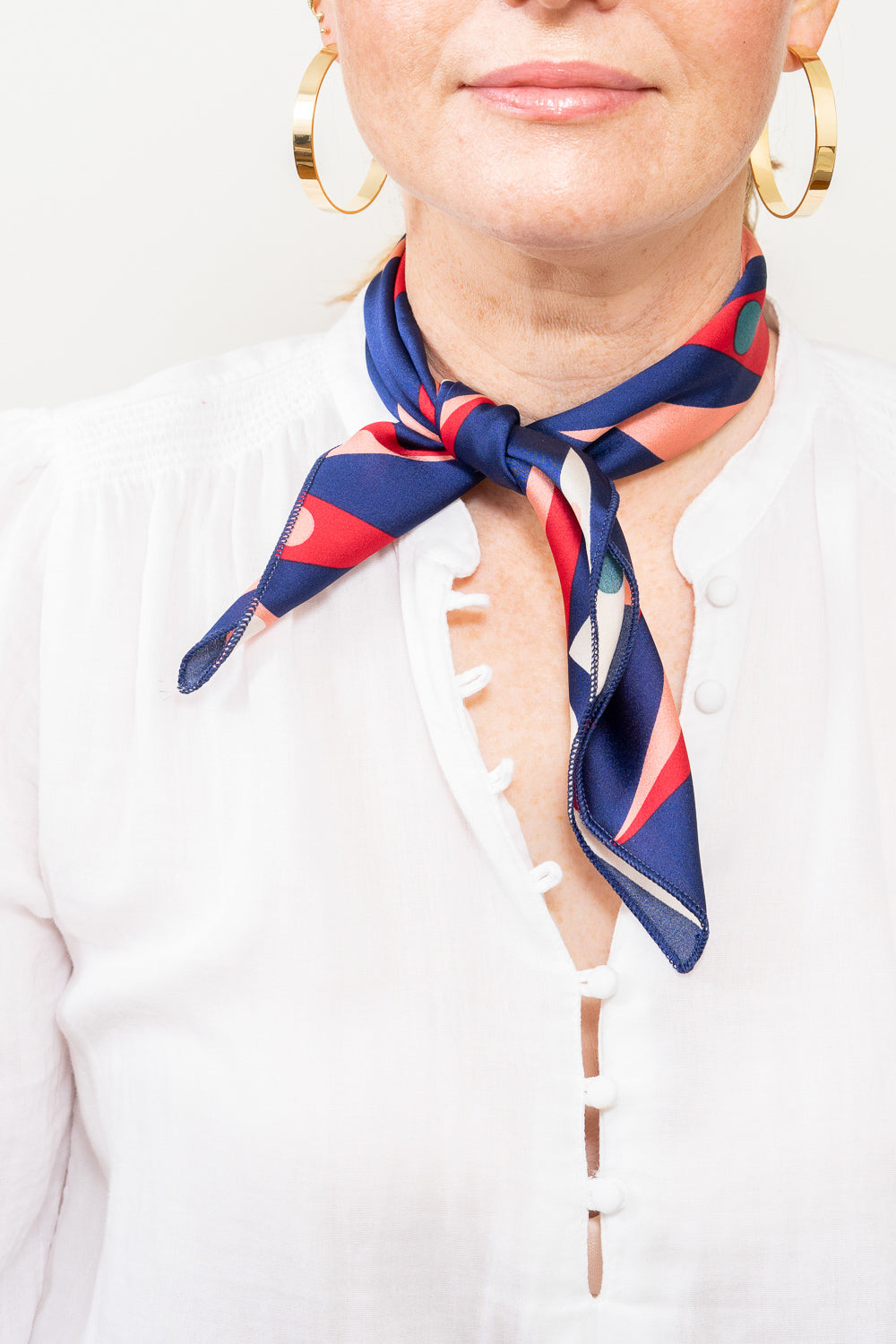 blue and red print scarf neck tie on model