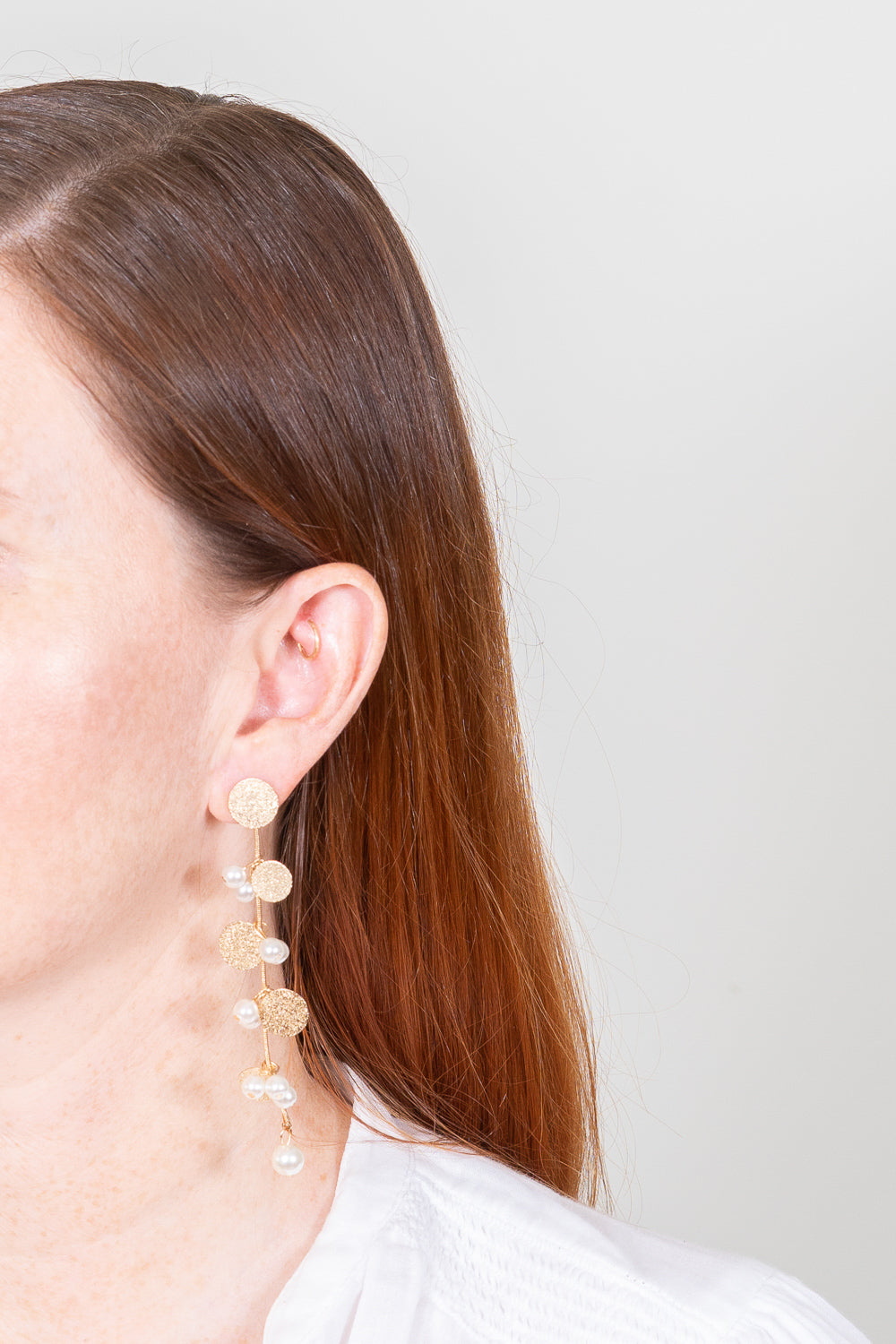 pearl earrings dangle gold discs on red hair model