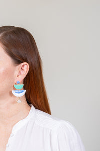 red haired model wearing tiered blue aqua enamel chandelier earrings