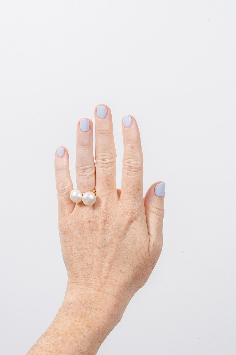 pearl lollipop gold ring 14k janna Conner on model hand