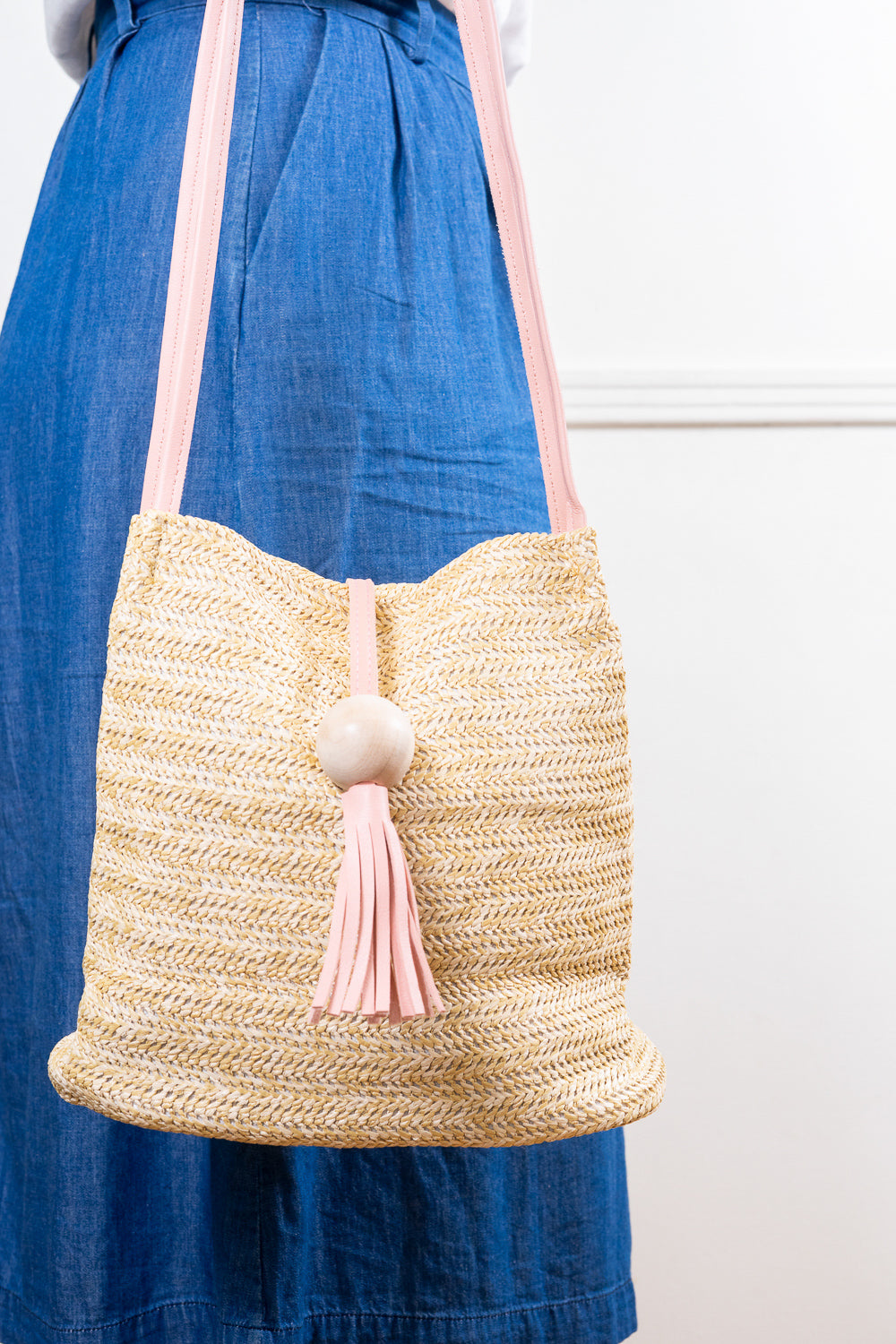 pink tassel shoulder bucket bag straw tote bag with jean skirt