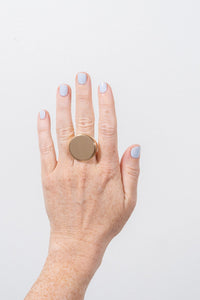 large gold signet ring on hand